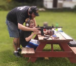Gary teaches son, Rylie, how to shoot